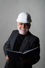 Man in hard hat smiles