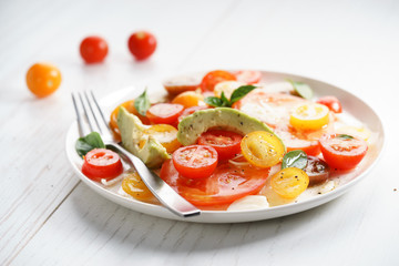 Tomato, avocado and red onion salad