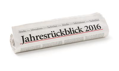 Zeitungsrolle mit der Überschrift Jahresrückblick 2016