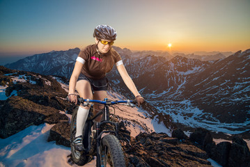 girl cyclist in the mountains on a mountain bike