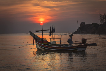 Sunset fishing boat on the sea, Thailand