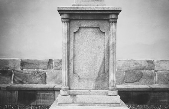 Decorated stone pedestal. Architecture is made in classicist style. Black an white with vignetting