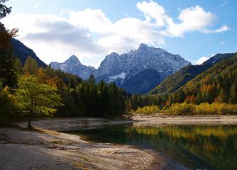 Fototapete - Jasna Lake near Kranjska Gora in Slovenia, looking resplendent in autumn colours.