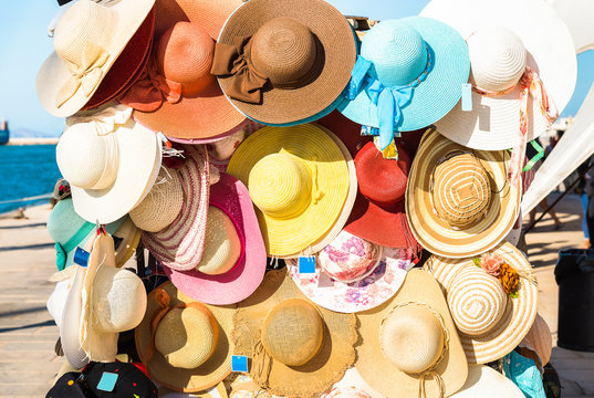 Colorful female summer hats for sale.