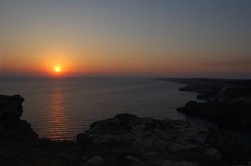 Sunset above the sea, mountain