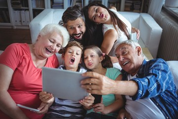 Multi-generation family taking a selfie