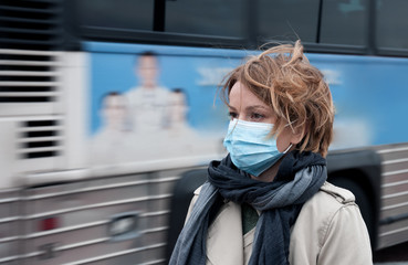 Woman with a medical face mask at outdoor