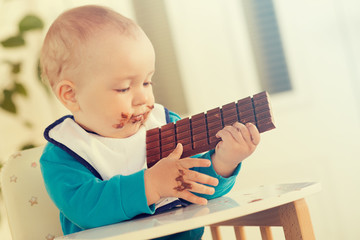 Baby boy eating chocolate