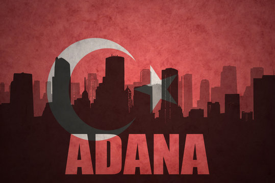 abstract silhouette of the city with text Adana at the vintage turkish flag background