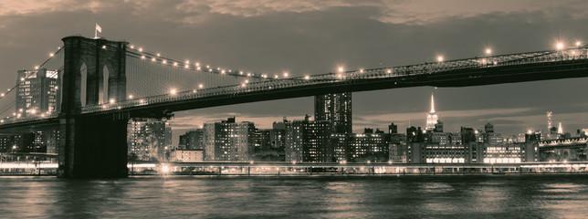 Vintage image of the Brooklyn Bridge illuminated at night