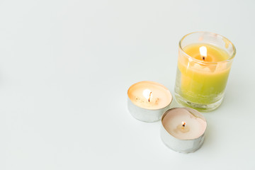 Beautiful colorful scented candles isolated on white background