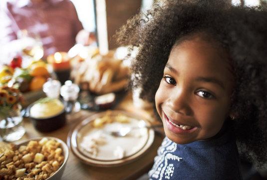 Little Girl Eating Thanksgiving Celebration Concept