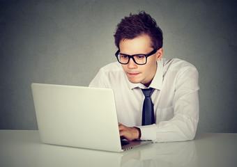 Man using his laptop computer