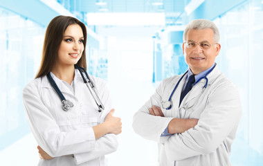 Doctors on blurred hospital background. Medical service concept.