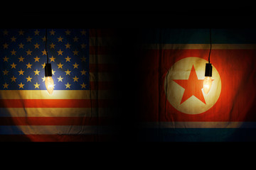 USA and North Korean flags. Relations between the countries, the threat of war. that is hidden.