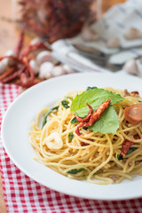 Spicy spaghetti with sausage, basil and chilli