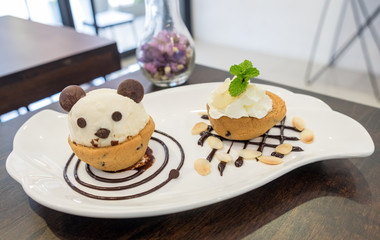 Nutella cookie cup ice cream panda on chocolate decor dish