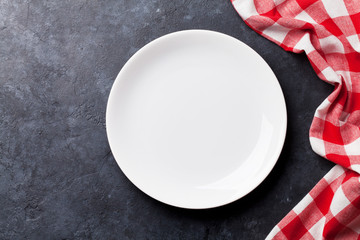 Empty plate and kitchen towel