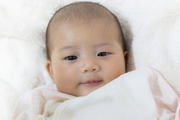 Close - Up Two month old new born asian cute baby smile rests ha