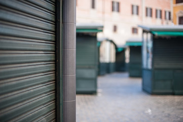 Closed stall shop in urban street rolling shutter close up