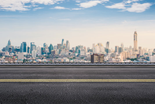 roadside with cityscape background