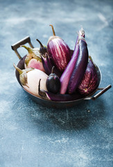 Colorful purple eggplants over linen napkin. Copy space.