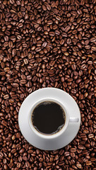 Coffee cup on roast coffee bean with text copy space. vertical
