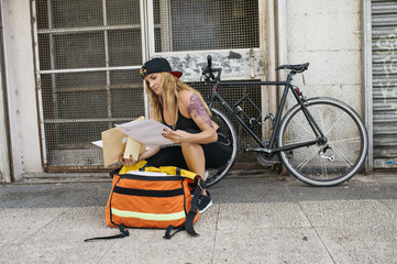 Woman watching documents outdoors.
