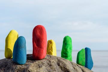 Painted stones on seashore