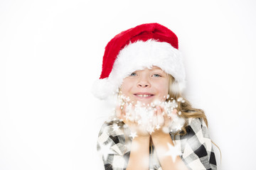 Happy christmas girl in Santa hat on white background