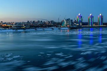 city  evening river ice lights
