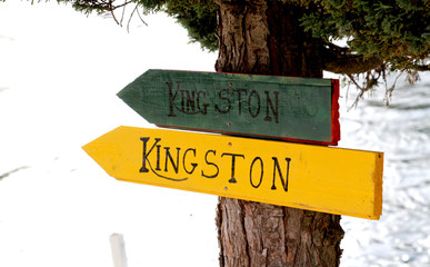 Tourist sign Kingston on wood