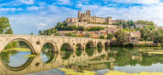 Panoramic view at the Old Bridge over Orb river with Cathedral of Saint Nazaire in Beziers - France