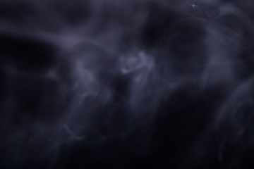 Cloud of smoke on black background. Selective focus
