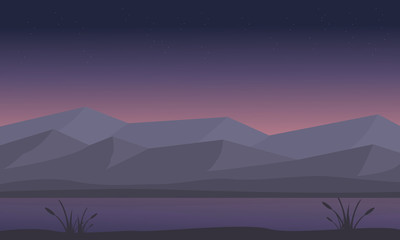 Silhouette of mountain and river at night