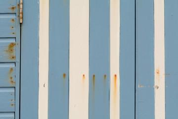 Blue and white striped beach hut