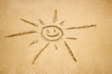 Sun drawing in the sand