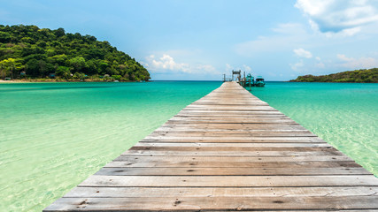 Wall Mural - Old wooden bridge with beautiful turquoise sea