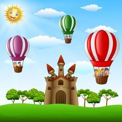 Cartoon kids riding in a hot air balloon near the castle