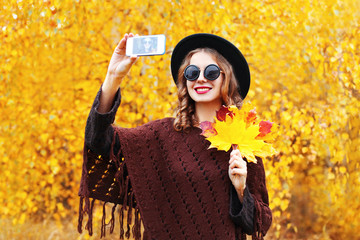 Portrait fashion smiling young woman taking autumn picture makes