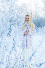 Model in winter forest