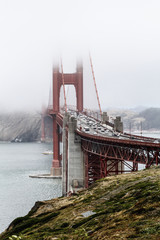 View of Golden Gate Bridge over bay of water during foggy weather, San Francisco, California, USA