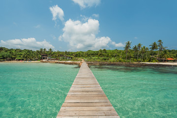 Wall Mural - Wooden bridge for entry to the remote island