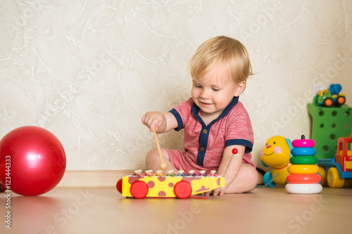 Portrait Of A Beautiful Baby Boy On The Floor With Car Toys 1 5