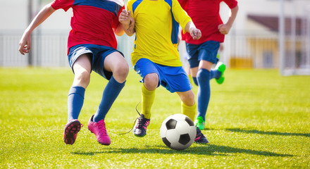 Children play football. Soccer football game for youth. School soccer tourmanet for kids