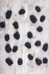 Blackberries on a wooden table and mint leaves