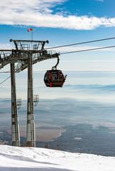 ski lift in winter mountains