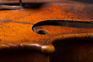Old broken violin close up