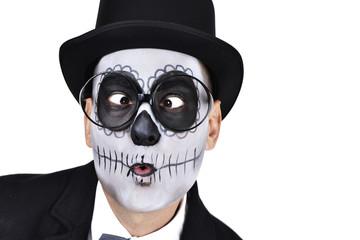man with a mexican calaveras makeup crossing his eyes
