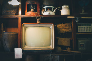 Retro television in cover wood in front wall